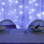 wedding or dinner table place setting, purple lights decor